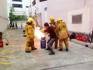 34715796-practicing-about-how-to-extinguish-the-fire-by-turning-off-the-stock-photo